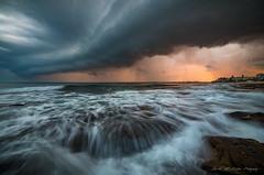 **Sunset Storm Front** (damian.mccudden1) Tags: landscapes nature fineart qld australia sunshinecoast sunset stormy stormfront canon samyang water orange rocks caloundra explore flickr mothernature wild