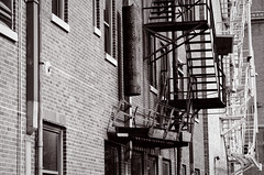 wasting my time in the waiting line (fallsroad) Tags: tulsaoklahoma urban downtown fireescape stairs ladders brick building bw blackandwhite nikond7000