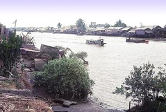 Canal with riverboats (Gene Whitmer) Tags: canal dinhtuongprovince 1972 riverboats mekongriver