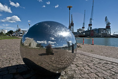 Helsinki - Porto (rosella sale) Tags: finlandia helsinki porto sfera acciaio riflesso viaggi travel nuvole gru nordeuropa mare fotorosellasale pietra pavimento