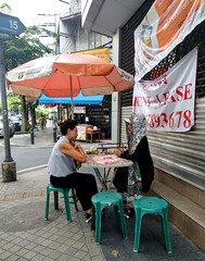 Fortune teller and sign for English speaking lawyer-dectective (ashabot) Tags: fortuneteller bangkok thailand streetscenes street cardreader thai