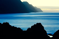 shades of blue... (clicheforu) Tags: ocean travel sunset cliff mountain colors silhouette rocks azores saojorge shadesofblue acores clicheforu fajadeouvidor