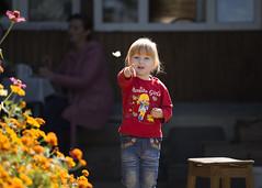 look! (monorail_kz) Tags: flowers red portrait orange girl butterfly kid dof depthoffield counterlight