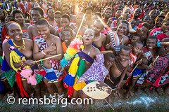 Ludzidzini, Swaziland, Africa - The Swazi Umhlanga, or reed dance ceremony, 100,000 unmarried women , or maidens, celebrate their virginity by bringing reeds for the Swazi Queen Mother's Kraal during this 8 day long annual tradition and dancing in a massi (Remsberg Photos) Tags: africa travel costumes usa tourism nude women breasts colorful culture event tradition virginity swaziland manzini umhlanga reeddance africanethnicity ludzidzini