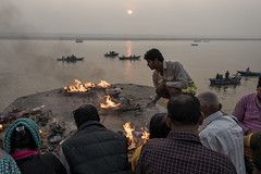 At Varanasi (Ravikanth K) Tags: travel people sun india reflection water sunrise boats fire boat worship outdoor culture dev varanasi pooja ritual diwali hindu kashi deepawali banaras karthika pournami kasi 500px karthiga