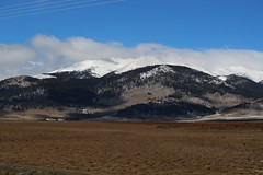 View from US-285 near Como, CO (Phil Spell) Tags: canon colorado mountains trees plants usa unitedstates rockymountains northamerica rocks rockformations snow forest clouds sky mountainside mountainpeak ridge mountainridge plains grass buildings