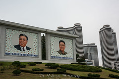 Mosaic Portraits of President's Kim Il Sung and Kim Jung Il by new apartment blocks in Pyongyang, North Korea (DPRK) (tommcshanephotography) Tags: adventure asia communism dprk democraticpeoplesrepublicofkorea expedition exploring kimilsung kimjungil kimjungun northkorea pyongyang revolution secretcompass travel trekking
