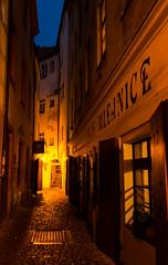 Light at the End of the Alley (dlerps) Tags: lerps daniellerps czech czechrepublic prague praha prag tschechien sony sonyalpha sigma a77 sonyalphaa77 sonyalpha77 sonya77 europe europa street window door mlejnice restaurant night long expsoure bluehour lights narrow alley