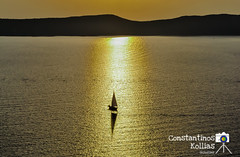 sunset.. (ckollias) Tags: sky sea sunset color water boat greece sun light summer beautiful colorful pylos