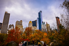 autumn in central park (kaimonster) Tags: centralpark nyc park newyorkcity manhattan newyork fall auntumn leaves outdoors outside skyline skyscrapers urban nature bridge people buildings city