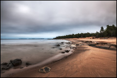 Faboda Beachen (Jonas Thomn) Tags: sand beach strand stones stenar rocks cliffs klippor sky himmer clouds moln mulet overcast cloudy longexposure lngexponering sea hav havet vatten water skog forest trees trd