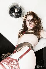 When they kick at your front door How you gonna come? With your hands on your head Or on the trigger of your gun? (Busha_b) Tags: portrait stockings bathroom model makeup lingerie latex smear suspenders stark trashy glitterball