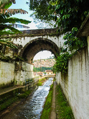 Bridge @ Ouro Preto (D Song) Tags: old city travel bridge blue sunset brazil sky panorama mountain playing mountains streets green church southamerica water architecture kids clouds america buildings studio children view michigan south churches panoramic historic cobblestone vista belohorizonte hilly favela ouropreto slums tcaup acabamundo