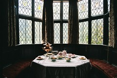 Tea for two (or several) (zawtowers) Tags: camera house film window glass liverpool table bay hall large property tudor stained together national meal area trust former seating manor intimate cosy laid nikonf80 merseyside speke nikonafnikkor2880mmf3356g