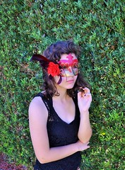mystery under the mask (Chicks Who Take Pics) Tags: sunset red woman brown tree green love nature girl beautiful sunrise wow hair photography photo leaf bush mask gorgeous buh whoa