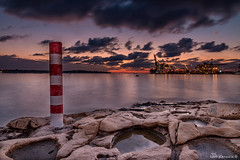 Malta Freeport (glank27) Tags: seascape sunrise canon landscape photography eos is rocks raw malta usm dslr freeport shipping efs hdr blending birzebbuga f3556 70d 1585mm