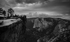 Hiker on Taft Point, Yosemite NP (tr0mbley) Tags: yosemite national park taft point nikon d810 clouds overcast black white bw monochrome el capitan ansel adams mountains granite cliff valley nature backpacking hiking climbing california road trip west sierras sierra nevada range