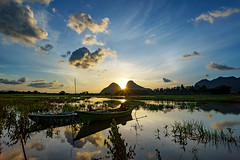 PROMISING DAY (mozakim) Tags: timahtasoh perlis sunrise boats fishing calmness tranquility morning clear sky clouds grass rays light shine hot blue hills bukit cabang