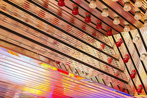 Great ceiling in the Palace Arcade on Lowestoft pier #lights #lighting #light #bulbs #mirror #angles #bright #red #orange #silver #reflection #reflections #seaside #pier #lowestoft #suffolkbuildings #suffolk #ceiling #dayout #arcade