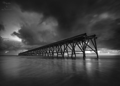 Standing against the Elements (Lee Summerson) Tags: mono monochrome blackandwhite canon canonuk mycanon hartlepool northeastengland northsands steetly pier ocean thenorthsea water longexposure slowshutter tokina1116mm moody dramatic sky clouds grey sunriseinmono blackandwhitesunrise