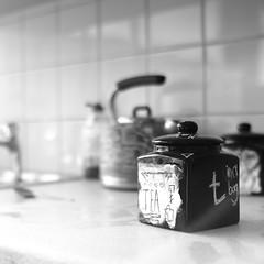 The Dog House (Andrew Malbon) Tags: leica leicam9 m9 summilux 35mmf14 35mm f14 monochrome mono mydogsighs street streetart handpainted handmade strongisland interior handheld rangefinder paint tea teacaddy font kettle sink kitchen