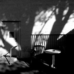 Rendez-vous with the extraordinary language of shadows and light (Dom Guillochon) Tags: table chair outdoors time life urban sunlight existence reality dream tree wall door shadows light noiretblanc