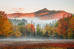 Chocorua (Robert Allan Clifford) Tags: newhampshire atmosphere autumn chocorua color fall fog foliage historic lake mist mountainrange moutain moutains nh reflection robcliffordphotography robertclifford robertallancliffordcom scenic sky trees view water weather whitemountainnationalforest whitemountains