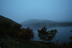 Lights On The Water (TheNovaScotian1991) Tags: morning autumn fallcolors appalachianmountains bay water atlanticocean villagelights lightsonthewater reflection nikond3200 kitlens 1855mm trees morningmist mistymountains fog ingonish canada capebretonisland capebretonhighlands novascotia