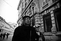 _DSC8278 (stimpsonjake) Tags: nikoncoolpixa 185mm streetphotography bucharest romania city candid blackandwhite bw monochrome oldcouple man woman elderly face portrait hat glasses
