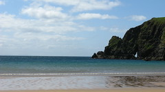 Malin Beg, Republic of Ireland (catherineloftis) Tags: beach ireland republicofireland cliff cliffs greenery landscape sand