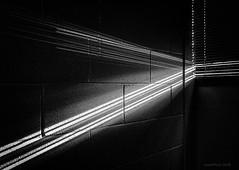 The Light Through Yonder Window (evanffitzer) Tags: light dark beams sunlight sun crack iphone7 cracks blinds diagonal lightplay hallway bw mono blackandwhite stream wall bricks shine afternoon sunny monochrome indoors wow