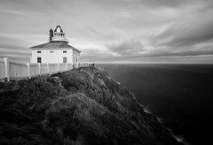 Edge of the World (Karen_Chappell) Tags: capespear lighthouse bw blackandwhite nd110 longexposure newfoundland nfld canada seascape atlantic ocean sea landscape atlanticcanada avalonpeninsula clouds sky fence canonefs1022mm wideangle scenery scenic