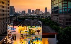 Traveler (Rob-Shanghai) Tags: china shanghai cityscape advertising sunset