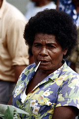 28-239 (ndpa / s. lundeen, archivist) Tags: city people woman color film face fiji 35mm hair natural market candid afro nick citylife streetphotography streetlife suva curly southpacific vendor marketplace 28 1970s 1972 hairstyle curlyhair streetmarket dewolf oceania fijian pacificislands nickdewolf photographbynickdewolf reel28