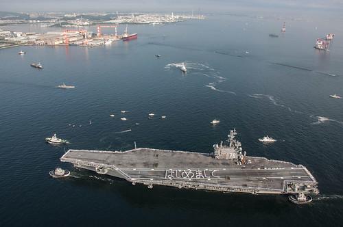 Sailors spell out Hajimemashite, nice to meet you, on the flight deck of USS Ronald Reagan.