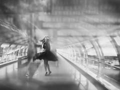 """Smile"" (helmet13) Tags: people bw woman smile fashion airport bright joy tube happiness groove windowreflection 200faves world100f leicaxvario indoorskylinkmovingwalkway"