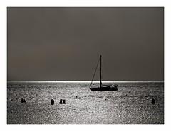 A Days End (kurtwolf303) Tags: ocean sea sky españa reflection topf25 dark boot boat spain topf50 topf75 meer europe 500v20f himmel tenerife santacruzdetenerife teneriffa topf100 lightshadow atlanticocean canaryislands spanien dunkel segelboot 800views omd digitalphotography islascanarias kanarischeinseln 2000views lichtschatten 900views 750views 1500v60f 1000v40f 250v10f playadelasaméricas monochromefineart systemcamera unlimitedphotos micro43 microfourthirds olympusem1