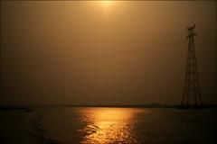 Irrawaddy River sunrise (*Kicki*) Tags: irrawaddy sunrise irrawaddyriver ayeyarwadyriver river water pylon skyline sky sun reflection horizon myanmar burma goldenhour sagaing mandalay marine