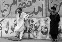 Kharadar Men (Fortunes2011. Closure of 6 years) Tags: men street candid random portrait portraiture portraits wall grafitti bw blackandwhite blackwhite monochrome