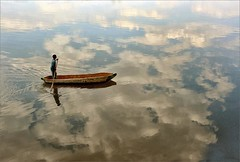 Chobe River, Botswana (me*voil) Tags: botswana chobe river still landscape boat man water clouds reflections dugout einbaum