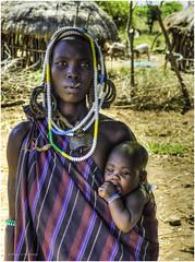 Mursi Tribe Woman and Child (Luc V. de Zeeuw) Tags: baby child ethiopia hut mun mursi omo omovalley tribe woman southernnationsnationalitiesandpeoplesregion