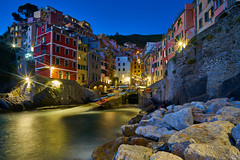 Riomaggiore at Dusk (Erik Pronske) Tags: houses water italy riomaggiore boats evening town sea australia rocks sydney newsouthwales colors architecture cinqueterre liguriansea village cliff mediterranean liguria it
