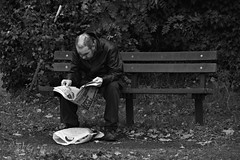 Read all about it. (Steve.T.) Tags: blackandwhite reading readinganewspaper newspaper sundaymirror sitting bench sittingonabench witham essex tramp carrierbag nikon d7200 sigma18200 streetscene streetphotography street person man scruffy untidy dishevelled