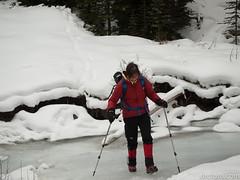 Barb Lauer crossing frozen creek (David R. Crowe) Tags: landscape mountain mountainscrambling nature outdooractivities scrambling turnervalley alberta canada
