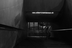 Lonely man (PIXXELGAMES - Robert Krenker) Tags: newspaper news cafe kaffee vienna wien snapshot unknown candid portrait portret schwarzweiss blackandwhite blacknwhite bnw fujifilm fujinon filmsimulation lifestyle street streetstyle urban streetphotographer streetphotography biancoenero lonely dark black white upstairs treppe man hat urbanlifeinmetropolis
