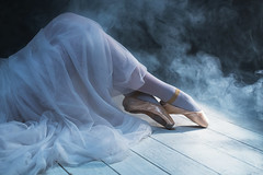 The feet of sitting ballerina in the smoke (Olga_Z1982) Tags: girls people ballet white color art classic beautiful beauty fashion sport studio photography foot shoe dance women ballerina opera slim dancing image background space stage smoke leg performance arts style dancer skirt professional achievement simplicity backgrounds classical balance pointe females sensuality performer tutu tiptoe elegance femininity