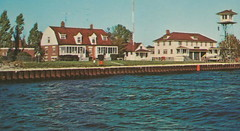"""CEN Ludington MI 1950s USCG Lookout Tower Channel Marker Station & Boat Launch Built 1933 had lifeboats mounted on rails original Station built 1880 for USLSS2 (UpNorth Memories - Donald (Don) Harrison) Tags: travel usa heritage history tourism st vintage antique michigan postcard memories restaurants hotels trailer roadside upnorth steamship cafes excursion attractions motels mackinac cottages cabins campgrounds city"""" bridge"""" island"""" """"car upnorthmemories rppc wonders"""" """"big """"railroad """"michigan memories"""" mac"""" """"state parks"""" entertainment"""" """"natural harrison"""" """"roadside ferry"""" """"travel """"don """"tourist """"mackinaw puremichigan stops"""" """"upnorth straits"""" ignace"""""""