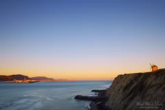 Molino de Aixerrota en Getxo al amanecer (Mimadeo) Tags: morning blue sea sky sunlight mill landscape coast spain rocks shoreline shore copyspace bizkaia euskadi vizcaya basquecountry paisvasco getxo clilff