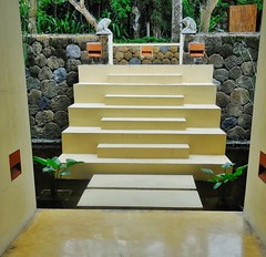 the sculptural steps (SM Tham) Tags: asia indonesia bali manggis alilamanggis resort hotel building corridor passageway garden steps pond water moat steppingstones stone walls frogs statues plants architecture landscapearchitecture design