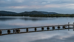 Cloudy sunrise and reflections on the bay (Merrillie) Tags: daybreak woywoy sunrise nature australia reflections nswcentralcoast newsouthwales clouds nsw centralcoastnsw water mountains wharf landscape outdoors waterscape blackwall centralcoast dawn mountain